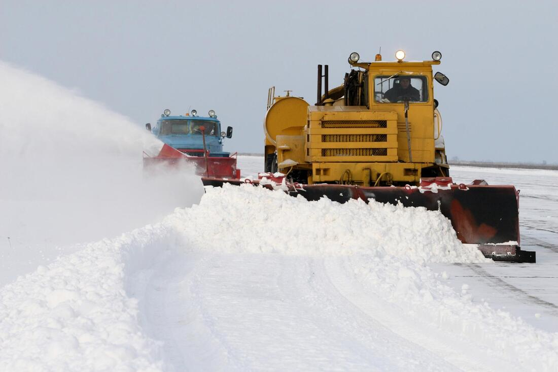 snow truck working on snow removal